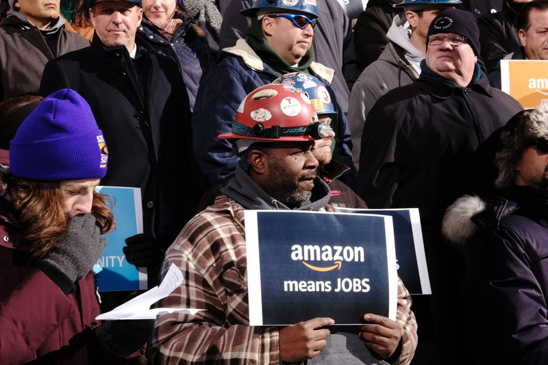 Demonstrators Protest While City Hall Addresses Economic Impact Of Amazon's New Headquarters