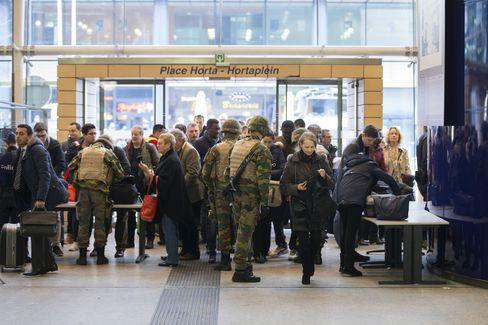 Soldiers check baggage at Brussels Midi train station.