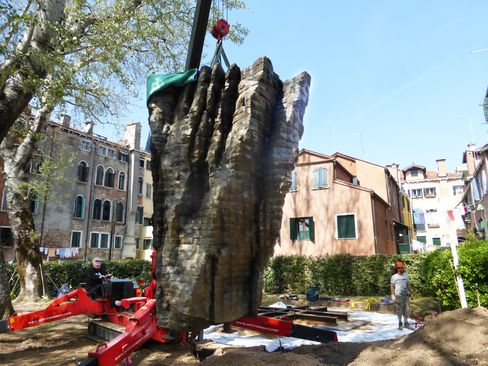 Lowering a sculpture into place. The sculptures required more than12 tons of steel armature underground for support.