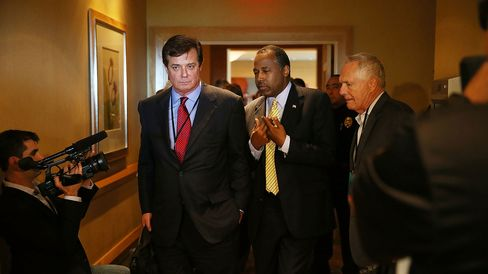 Trump strategist Paul Manafort (left) speaks with surrogate Ben Carson as they arrive for a reception at the Republican National Committee spring meeting on April 21, 2016, in Hollywood, Florida.