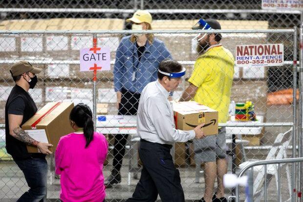 Former Arizona Secretary of State Ken Bennett carrying a box of ballots