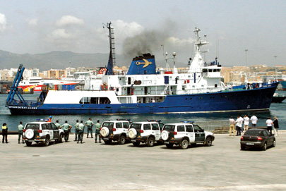Members of the Spanish Civil Guard stand next to Odyssey's 'Ocean Alert'