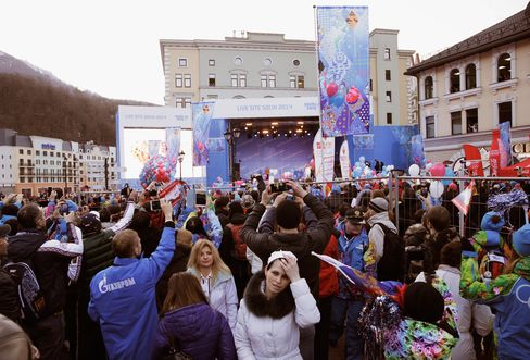 People Gather to See the Arrival of the Olympic Flame