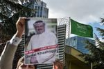 Protestors hold pictures of Jamal Khashoggi outside the Saudi consulate in Istanbul.