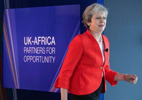 U.K.'s May Pledges Closer Ties Between Nigeria, City of London