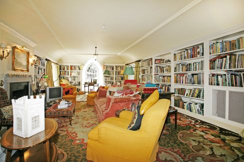 Yes, there's more modern, modest rooms in the castle, too—like this living room/library.