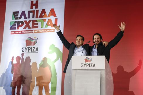 Alexis Tsipras, leader of the Syriza party, (L), is joined on stage by Pablo Iglesias, leader of Spain's Podemos party