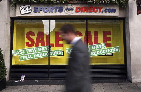 A Pedestrian Passes A Sports Direct International Plc Store