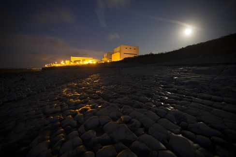 Lights illuminate Electricite de France SA's (EDF) Hinkley Point A nuclear power station.