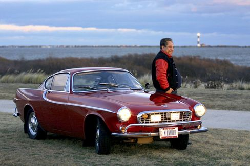 Irv Gordon stands next to his 1966 Volvo P1800. Gordon has driven the car more than 3 million miles.