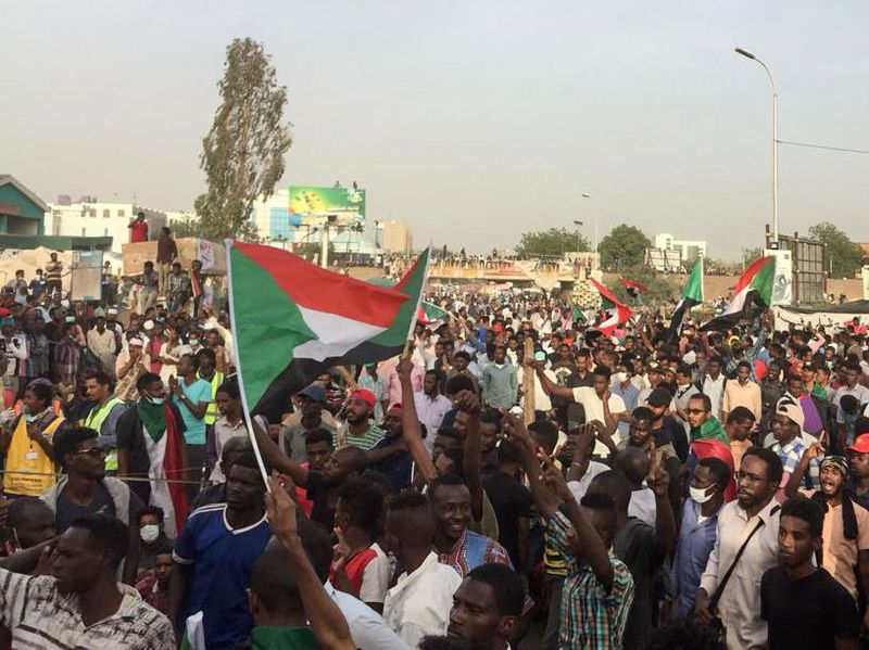 Protesters rally in front of the military headquarters in Khartoum on April 11.Photographer: AFP via Getty Images