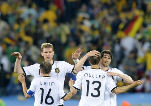 Germany's players celebrate after beating Australia