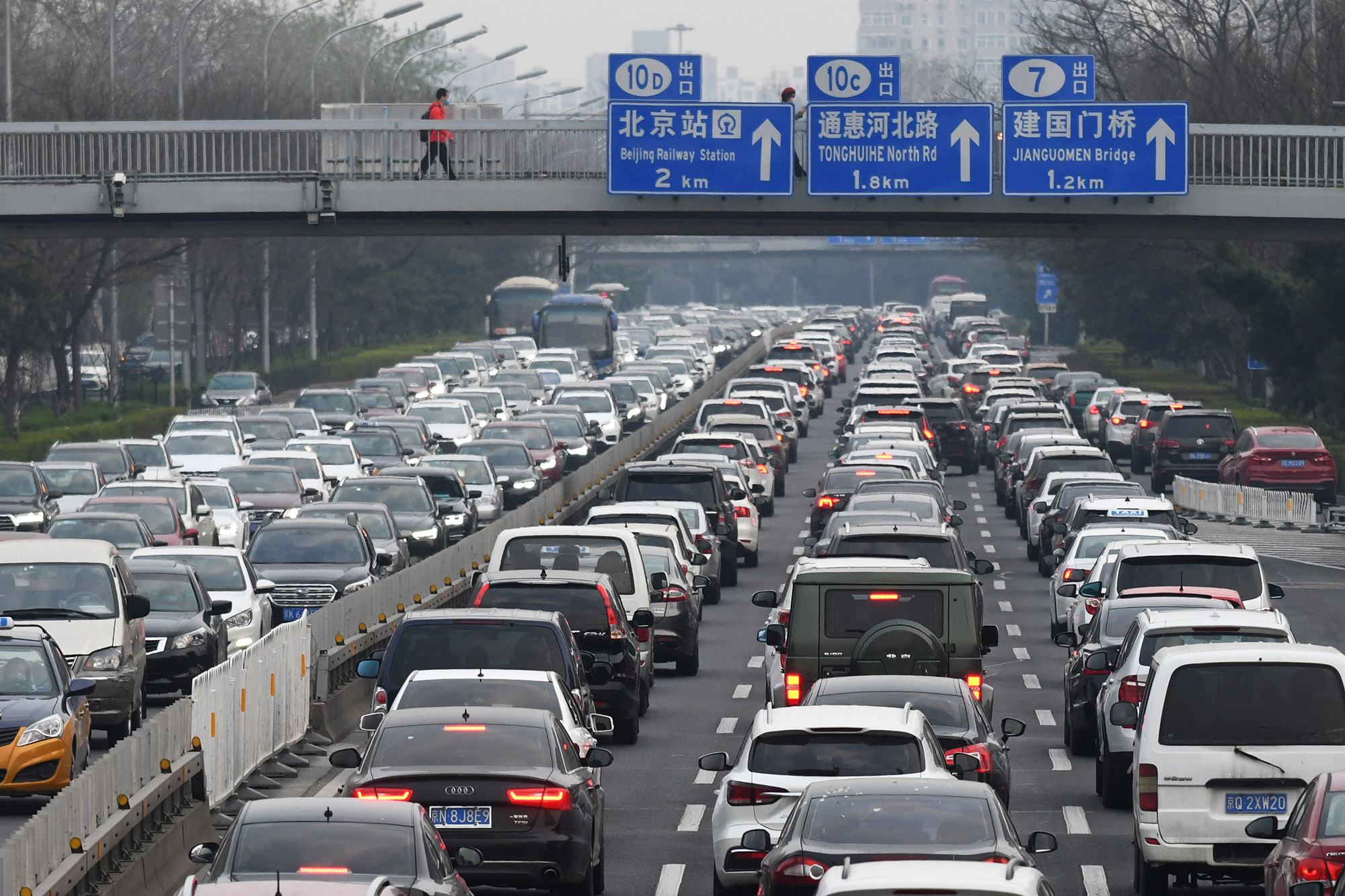 Cars crowd the Second Ring Road in Beijing as traffic gets back to normal.