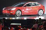 1504482147_tesla red car