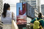 A public screen displays an image of Chinese flags in Shanghai, China, on Wednesday, Aug. 18, 2021.