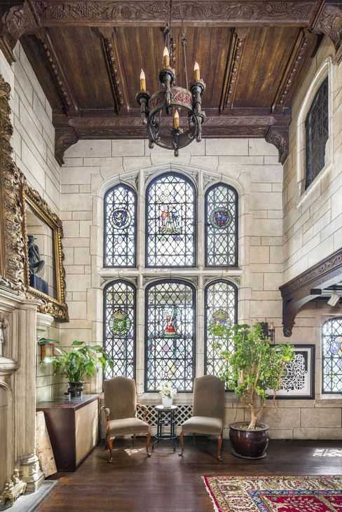 The apartment has a variety of stained-glass windows.