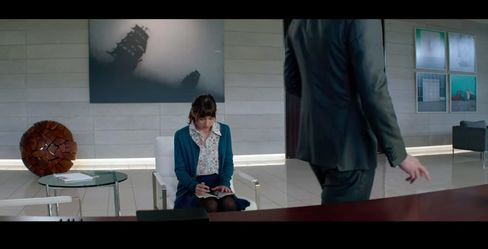 Nevermind the interview. Ana should be taking note on the office art. (Still from official trailer.)