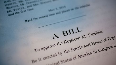 A copy of S. 2280, a bill which would approve the Keystone XL Pipeline, is arranged for a photograph in Washington, D.C., U.S., on Monday, Nov. 17, 2014.