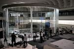 Members of the media gather inside the Tokyo Stock Exchange (TSE), operated by Japan Exchange Group Inc. (JPX), in Tokyo, Japan, on Thursday, Oct. 1, 2020.