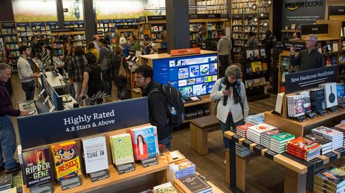 Customers shop inside Amazon Books in Seattle, Washington, on Nov. 3, 2015.
