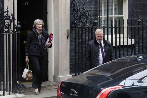 Theresa May leaves for Parliament, Jan. 25.