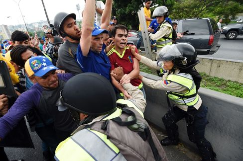 Capriles, center, during a protest in Caracas on May 11.