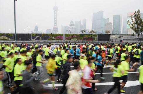 Participants run during the 2015 Shanghai International Marathon