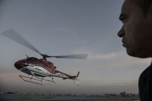 A security officer looks on as an UberCopter lands at the Blue Tree Hotel Heliport in São Paulo on June 17, 2016.