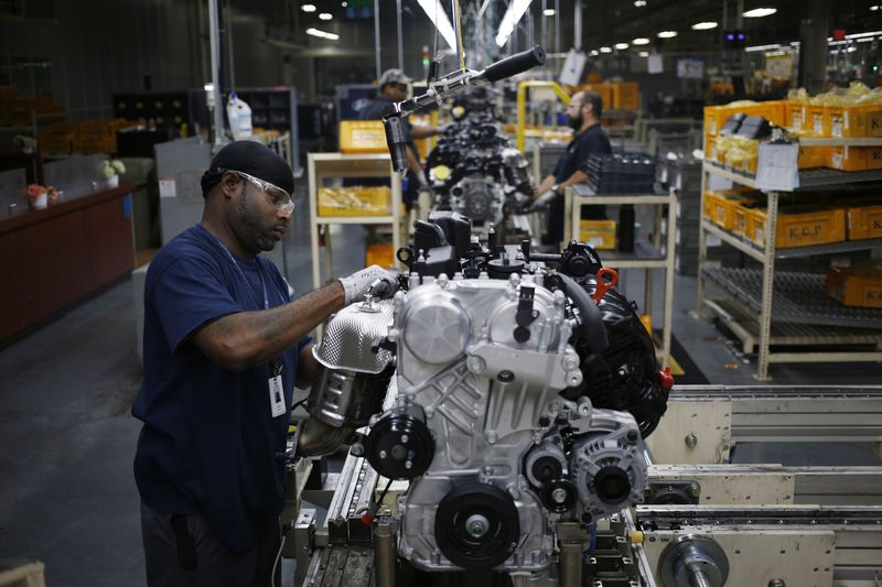 An Employee Assembles An Engine On The Production Line At The Hyundai Motor  Manufacturing Alabama (HMMA) Facility In Montgomery, Alabama, On July 19,  2017.