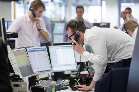 Financial traders at ETX Capital in London on June 24.