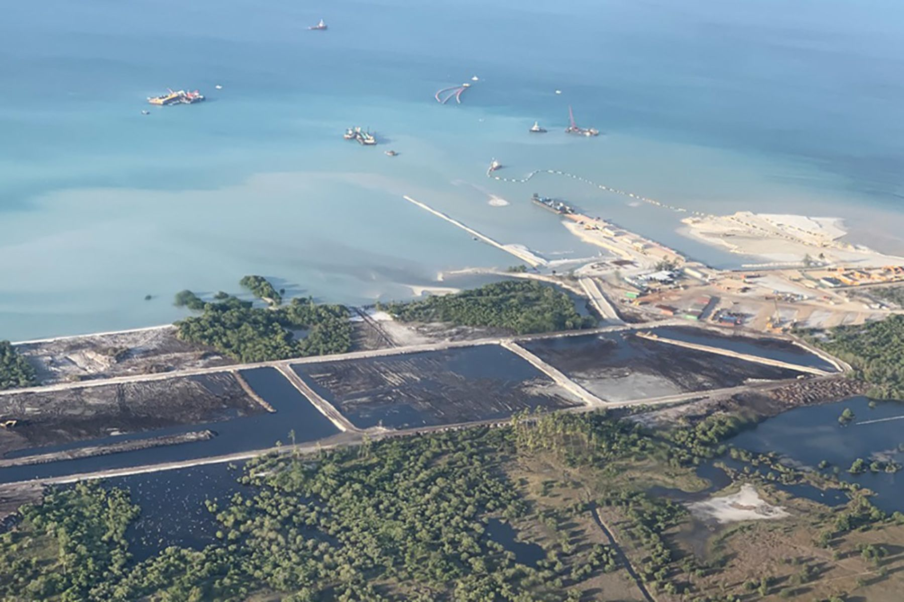 Construction work at the early beach landing facility where companies including Total SA plan on building giant liquefied natural gas storage tanks for export, June 18, 2020.