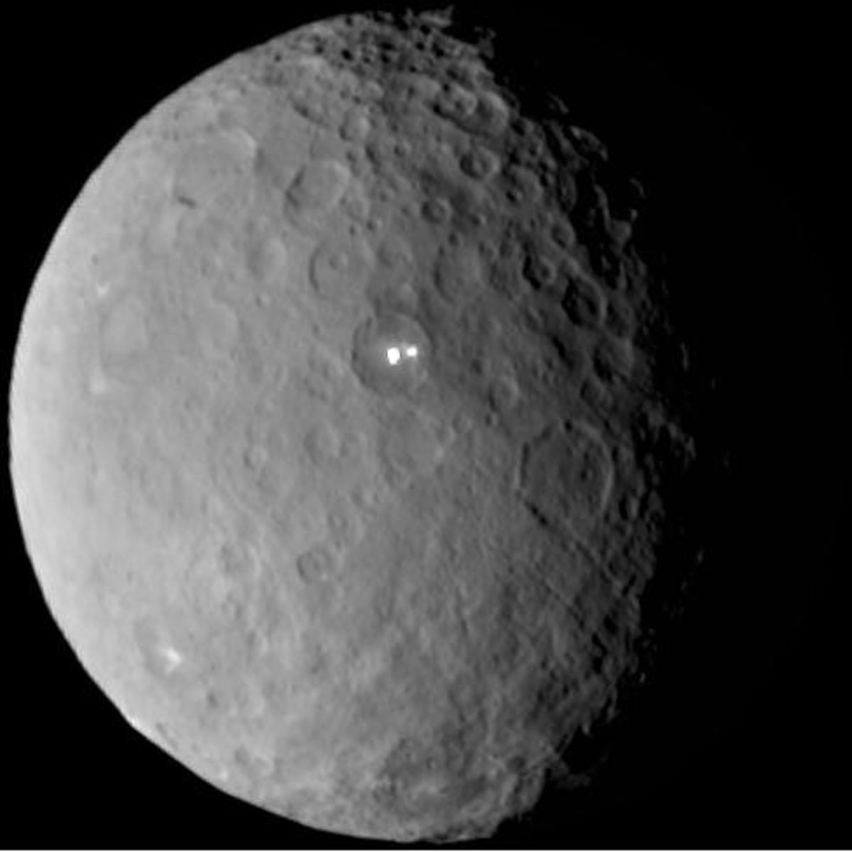 Is The Mysterious Light On This Dwarf Planet A Sign Of Life