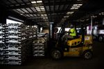 A worker uses a forklift to move aluminum ingots in a warehouse at the Port of New Orleans in Louisiana, U.S.
