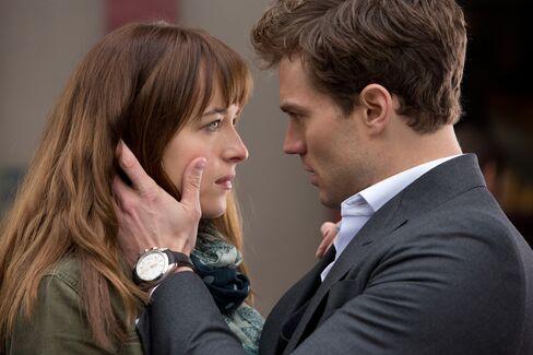 Christian (Jamie Dornan) seduces Anastasia (Dakota Johnson) with a look—and a bespoke suit.