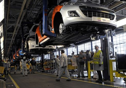 Employees Work on Peugeot-Citroen Automobiles in Paris