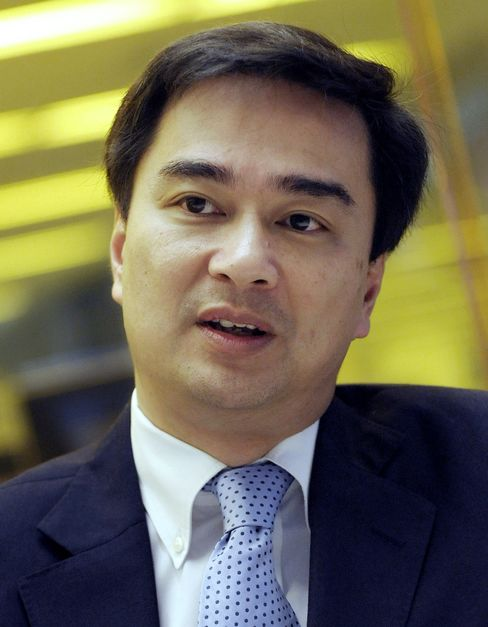 Abhisit Says May 'Do More' for Thailand Exporters