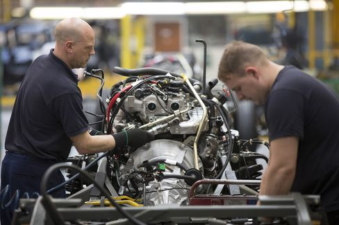 Employees Work On The Engine Of A TX4 Euro 5 London Taxi Cab