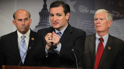 U.S. Sen. Ted Cruz (R-TX) (2nd L) speaks as Rep. Mo Brooks (R-AL) (R) and Rep. Louie Gohmert (R-TX) (L) listen during a news conference September 9, 2014 on Capitol Hill in Washington, DC.