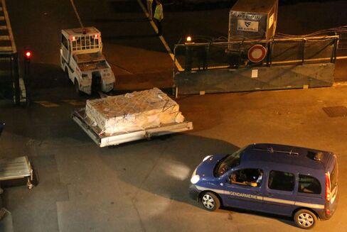Police Officers Escort Debris On Way To France