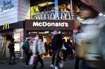 Pedestrians walk past a McDonald's restaurant in Tokyo.