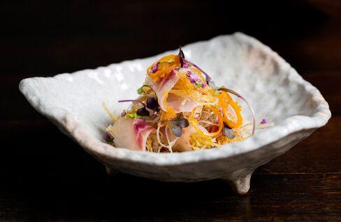 Seabass sashimi salad with myoga and shiso, apple oroshi and ponzu dressing.
