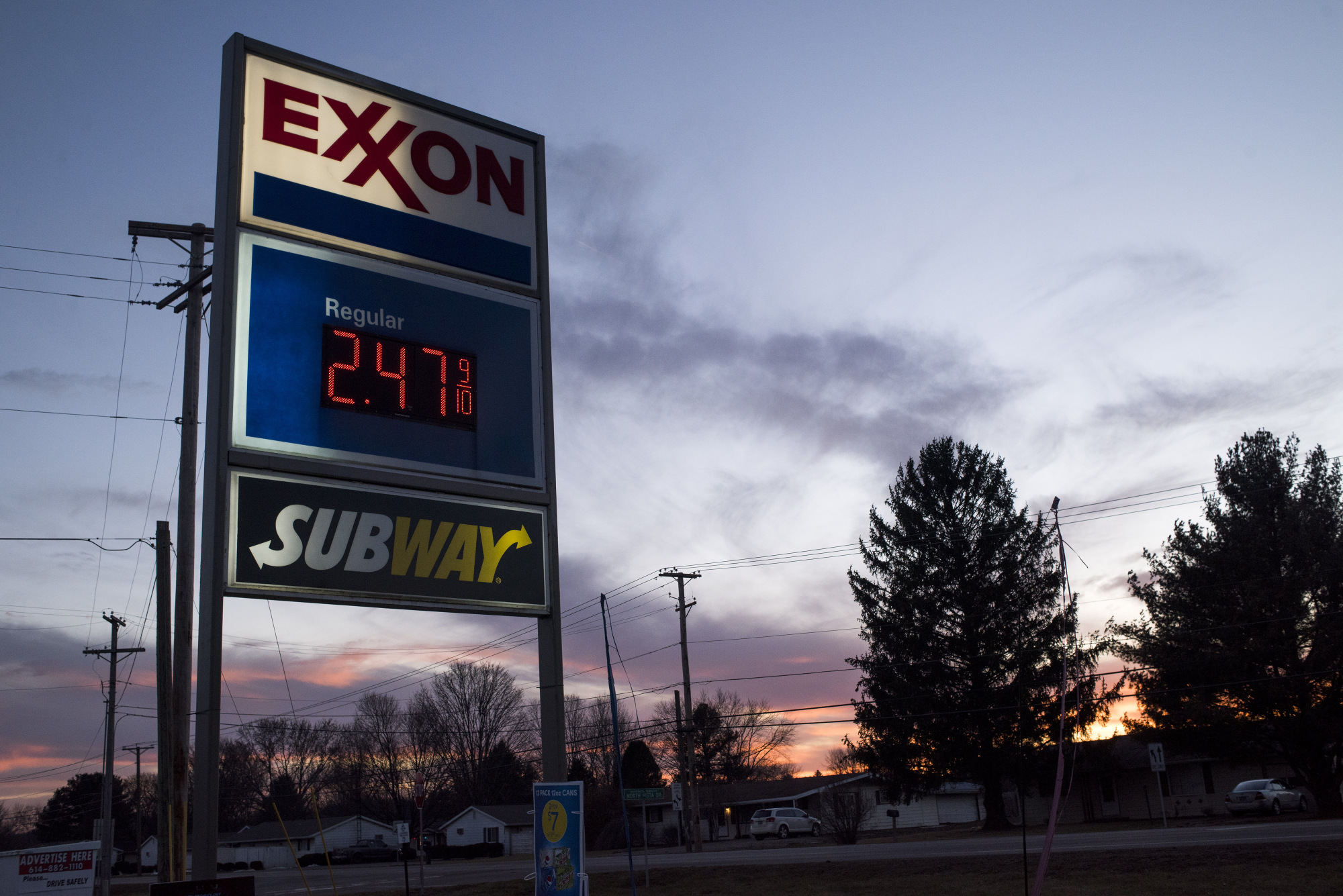 A sign displays fuel prices at an Exxon Mobil Corp. gas station.