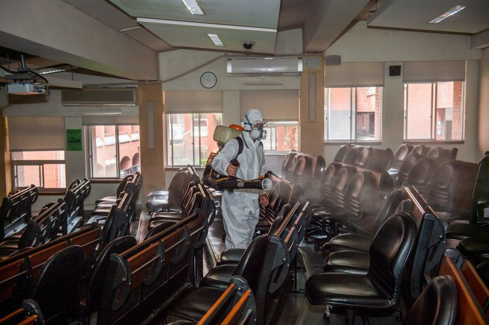A health worker sprays disinfectants at the National Taiwan Normal University on April 17.