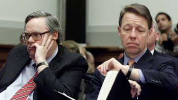 President Bill Clinton's personal attorney, David Kendall (right), looks at his watch as he and White House counsel Charles Ruff listen to independent counsel Kenneth Starr testify before the House Judiciary Committee on Nov. 19, 1998, on Capitol Hill.