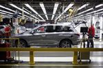 Workers perform final inspections on a vehicle at the Nissan Motor Co. manufacturing facility in Smyrna, Tennessee, U.S.