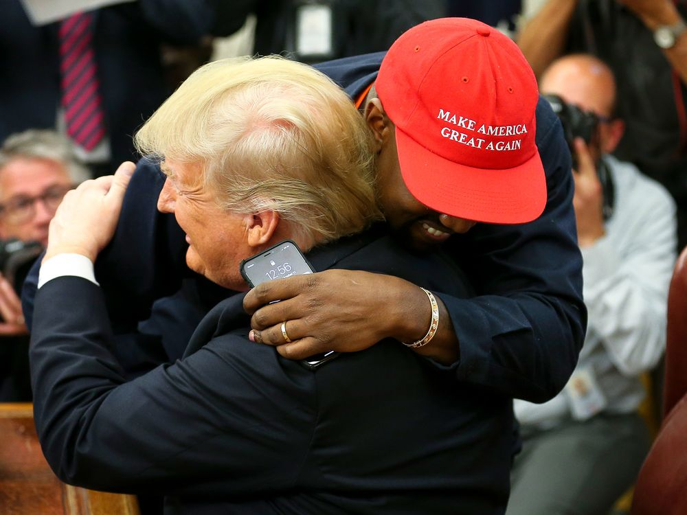 Donald Trump and Kanye West embrace during a meeting in the Oval Office in 2018.