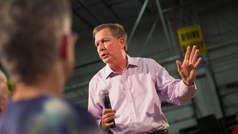 Ohio Governor John Kasich speaks to guests gathered for a town hall meeting on July 24, 2015, in Des Moines, Iowa.
