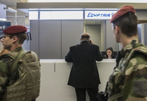 Soldiers patrol by the EgyptAir Airlines check in desk at Charles de Gaulle airport on May 19.