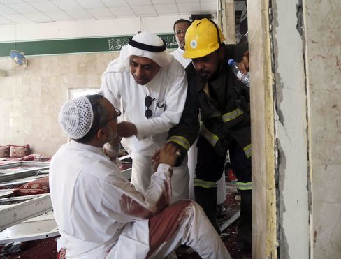 Emergency personnel attend the site of a bomb blast at the Shiite Imam Ali mosque during Friday prayers in a village in the eastern province of Qatif, Saudi Arabia, 22 May 2015.