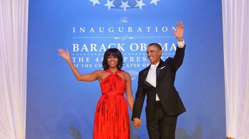 US President Barack Obama and First Lady Michelle Obama wave as they arrive for the Inaugural Ball at the Walter E. Washington Convention Center on January 21, 2013 in Washington, DC.